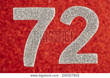 Number seventy-two silver color over a red background. Anniversary. Horizontal