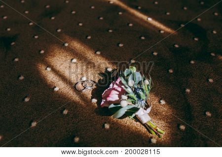 Beautiful Wedding Boutonniere Lies On The Floor