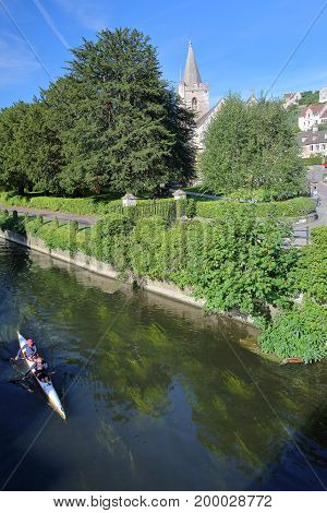 Bradford on Avon, UK - AUGUST 13, 2017: Rowing on the river Avon with Holy Trinity Church in the background