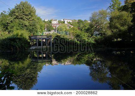 Reflections on river Avon towards Tory neighborhood in Bradford on Avon, UK
