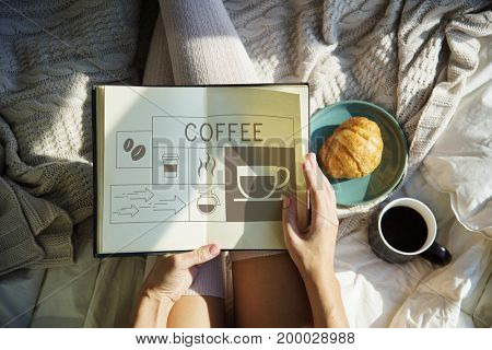 Hand holding book with Illustration of coffee shop advertisement