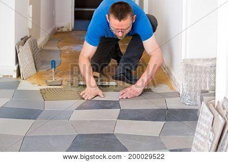 Tiler Placing New Floor Tiles