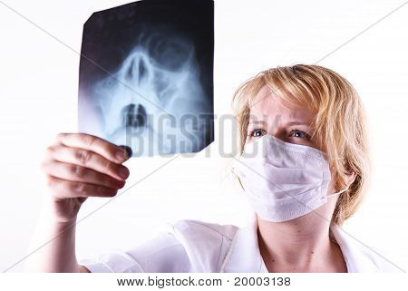 Female Doctor Looking At A X-ray