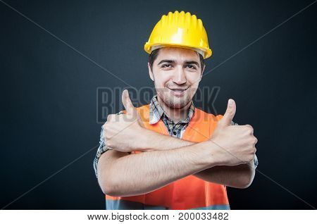 Constructor Showing Thumbs Up With Arms Crossed