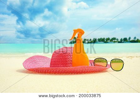 Beach accessories on sand at sea resort. Summer vacation concept