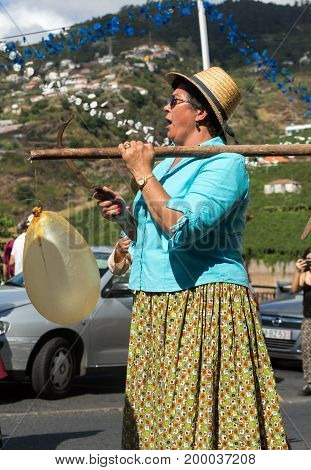 ESTREITO DE CAMARA DE LOBOS PORTUGAL - SEPTEMBER 10 2016: Women wearing in traditional costumes at Madeira Wine Festival in Estreito de Camara de Lobos Madeira Portugal. The Madeira Wine Festival honors the grape harvest with a celebration of traditional