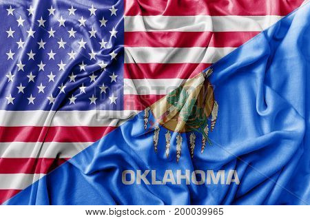 Ruffled waving United States of America and Oklahoma flag
