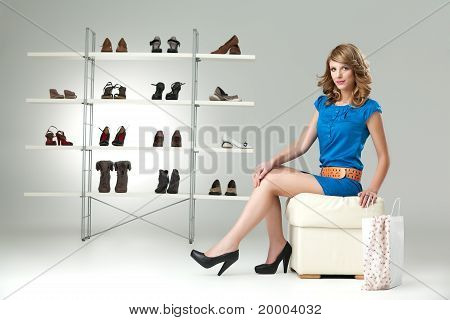 Blonde Woman Buying Shoes