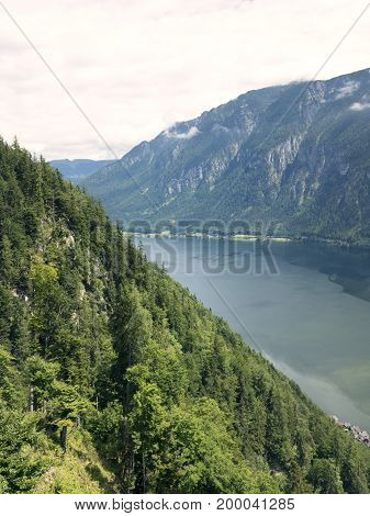 Mountain lake, Alpine massif, beautiful canyon in Austria. Alpine valley in summer, clear water. Healthy virgin mountain nature, destination for hiking, swimming vacation. Salzburg Hallstatt landscape