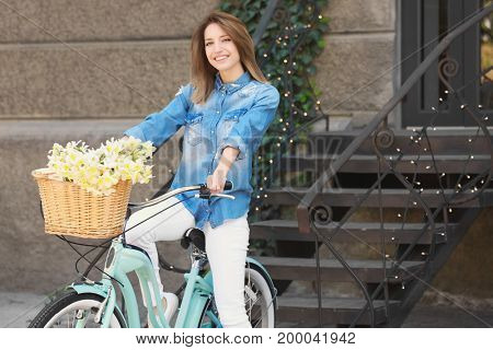 Young beautiful girl with bicycle on city street