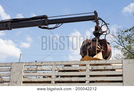 garbage truck with manual hydraulic. Claws of mechanical moving arm