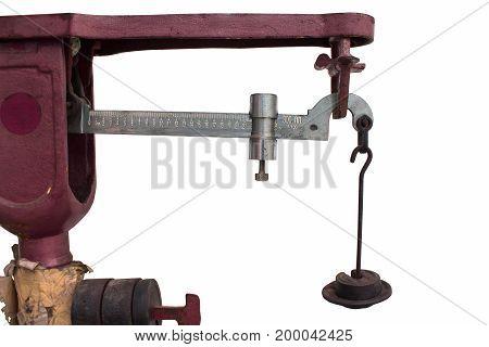 Weighing a kilo of steel pendulum on isolated.