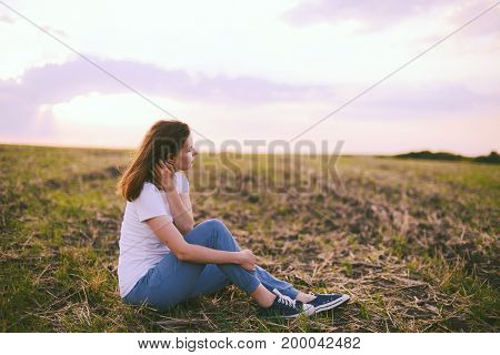 Young Woman Relaxing In Summer Sunset Sky Outdoor. People Freedom Style.