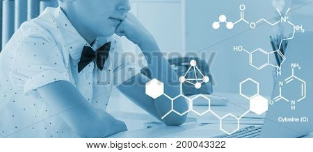 Digitally generated image of chemical structure against businessman looking at laptop