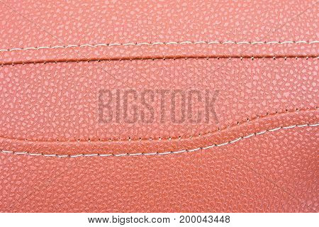 The texture of leather. sewn Upholstery leather.