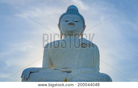 White Marble Statue Of Big Buddha On Blue Sky Background