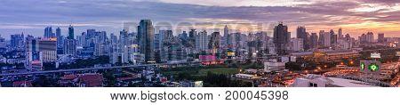 Bangkok Thailand - June 10 2011: Panorama view of evening Petchaburi Rd. with Makkasan BRT railway station which connect to Suvarnabhumi international airport