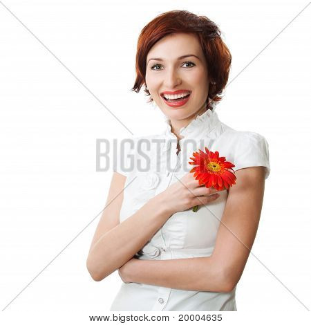 Beautiful Woman With Flower Gerbera In Her Hands Against White Background