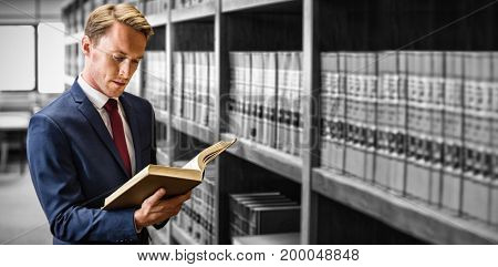 Handsome lawyer reading in law library at university