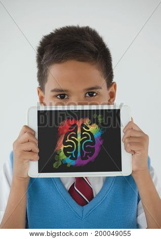 Digital composite of Boy holding a tablet with brain icon on screen