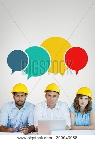 Digital composite of Construction people at a table with speech bubbles against grey background