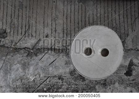 Cement pipe lid is part of the toilet or water closet For turning the dirt out and and empty space for text