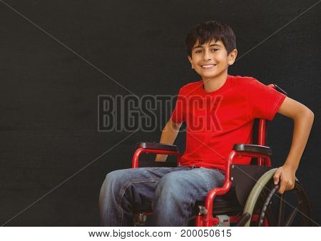 Digital composite of Disabled boy in wheelchair in front of blackboard