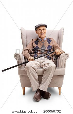Senior with a walking cane sitting in an armchair and looking at the camera isolated on white background