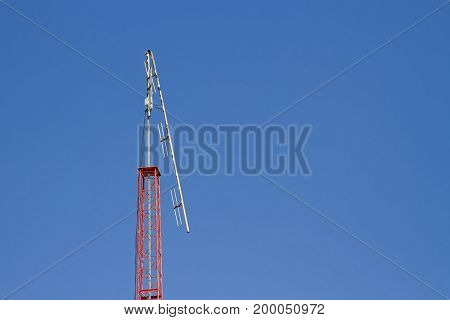 Broken radio pole with blue sky on day ligth