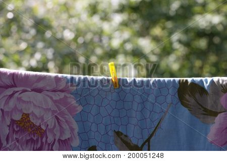 image of one one clothespin on blue bedsheet