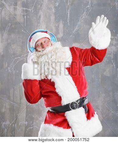 Santa Claus listening to music on grunge background