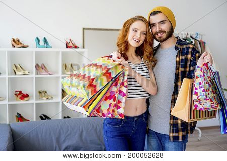 A portrait of a couple shopping in a mall