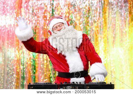 DJ Santa Claus playing music in club