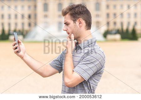 Handsome Man Use Smart Phone In Park