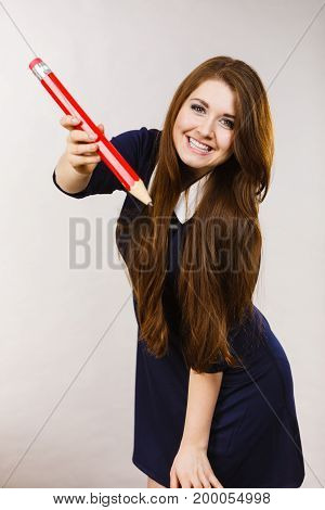 Smiling Woman Holds Big Pencil In Hand