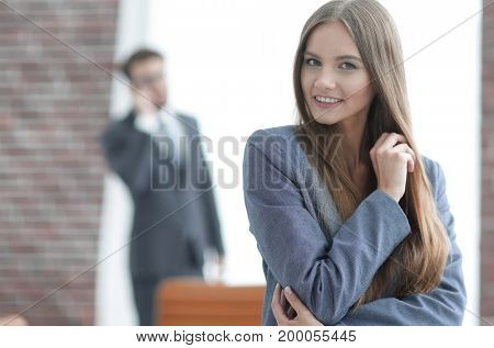 successful business woman on blurred background office