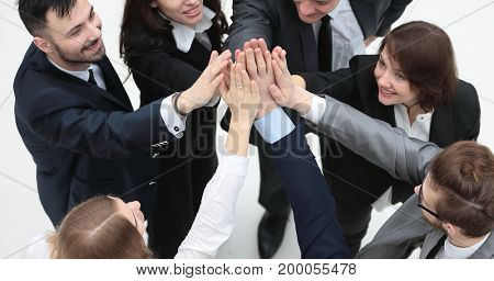 closeup. joyful business team with folded hands together