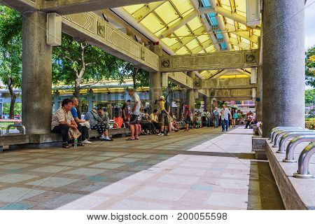 TAIPEI TAIWAN - JUNE 26: This is a park scene of people sitting under a pavilion on a sunny day in the Longshan Temple area on June 26 2017 in Taipei