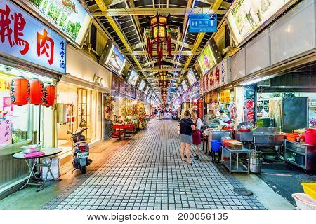 TAIPEI TAIWAN - JUNE 22: This is the Huaxi street night market an old traditional style night market where people go to shop and try different kinds of Taiwanese cuisine on June 22 2017 in Taipei