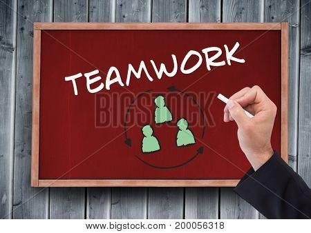 Digital composite of Hand writing teamwork on blackboard