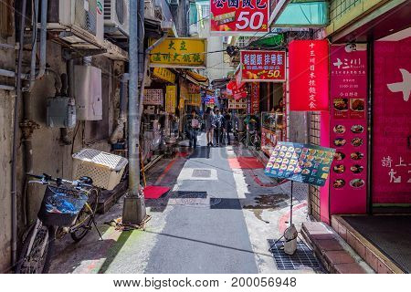 TAIPEI TAIWAN - JUNE 20: This is a side street with local restaurants in the busy downtown area near Taipei main station on June 20 2017 in Taipei