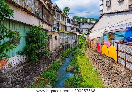 Old traditional houses with a stream and nature