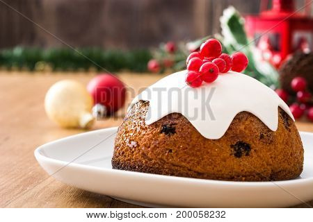 Sweet christmas fruit pudding on wooden table