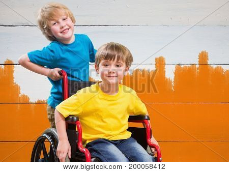 Digital composite of Disabled boy in wheelchair with friend with bright orange painted  background