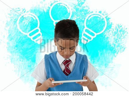 Digital composite of Schoolboy with tablet and light bulb graphics