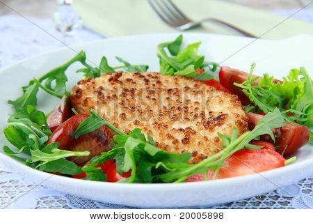 salad with fried cheese, arugula and fresh vegetables