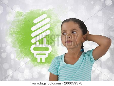 Digital composite of Girl thinking next light bulb graphic