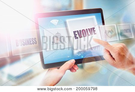 A Businesswoman Selecting A Evolve Business Concept On A Futuristic Portable Computer Screen.
