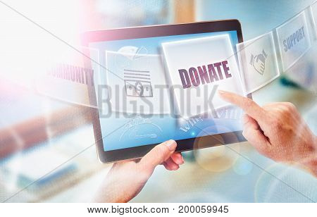 A Businesswoman Selecting A Donate Business Concept On A Futuristic Portable Computer Screen.