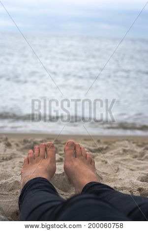 Woman lying at sea in cooler weather